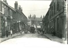 Originally the busy Sion Street was an important part of Radcliffe town centre. Here, in this scene dated 1922, the Railway and Newmarket Inn can be seen to the right.