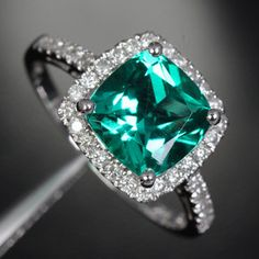 Beautiful piece of jewelry <3 Emerald and Diamond halo ring<3 My beautiful graduation present <3ethical, transparent, and sustainable jewelry