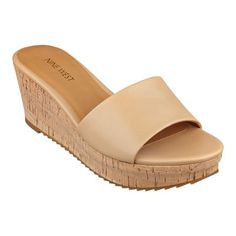 """Our Confetty platform cork wedge sandals are definitely a summer must-have. They go with everything from Capris and shorts to pants skirts. Front band slide. Padded footbed for all-day comfort. Leather upper. Man-made lining and sole. Imported. 1"""" platform. 2 1/2"""" wedge heels. Women's platform wedge sandals."""