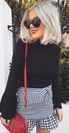 how to style a plaid skirt : black sweater and red bag