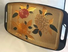 A gorgeous vintage lacquer ware Japanese serving tray. The flowers and leaves are raised from the surface creating a 3-D effect. The antique