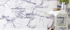 Calacatta Viola Polished Marble is an off-white marble tile with striking purple veining. Available in a variety of sizes for marble flooring and wall tiles. White Marble Bathrooms, Purple Bathrooms, Stone Tile Flooring, Stone Tiles, Mandarin Stone, Outdoor Stone, Marble Tiles, Calacatta Marble, Kitchen Gallery