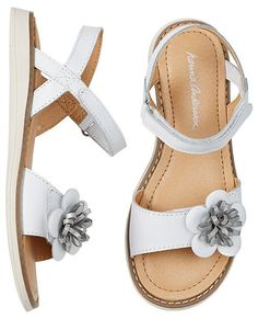 Flower-trimmed and ready for summer adventures! They're crafted with our super-comfy memory foam insoles—so extra soft it's like walking on little pillows.   <br>•Leather upper <br>•Wide toe strap with flower detail <br>•Super-comfy memory foam insole <br>•Easy hook and loop closure on ankle strap <br>•Polyurethane lining <br>•Rubber outsole <br>•Imported<br><br>For a fit that includes room to grow, order the US size your child's foot measure on the shoe ru...