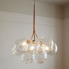 Looking for a way to spruce up your living space? Here are 4 DIY Chandelier tutorials. Wanna buy instead? I tell you where to get them.