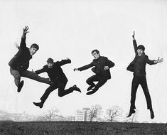 "The Beatles Iconic Jump Photo Was Rearranged For ""Love"" Album Logo 