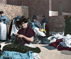 Woman knitting in a street market - Liverpool