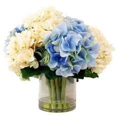 Create a lush tablescape or charming vignette with this blooming arrangement, featuring silk hydrangeas in a glass vase.  Product: