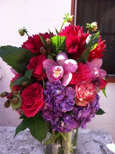 Mixed bouquet  with dahlias, garden roses, hydrangea and cymbidium orchid blooms.