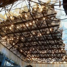 Mattress springs with lights used as a canopy over a bed. Such a cute idea.