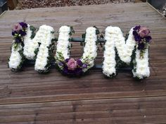 Funeral Flowers. MUM funeral flower letter tribute with ivy edging and lilac spr