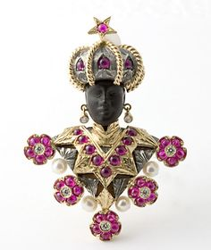 """18 kt. and Silver """"Moretto Paola"""" brooch set with Rubies. Nardi."""