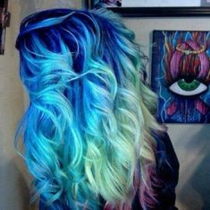 Bright blue roots, turquoise middle and mint green then light purple tips. Cool hair!