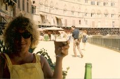 the tables are being cleared in the main piazza of Sienna for the Palio to take place as I sit and drink my Italian vino