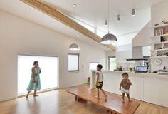 Kitchen with book shelf, Panorama House / Moon Hoon