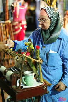 She is an old lady in Khan Elkhalili -Cairo... she use this old machine to told u about ur luck today ...just press the bottom and u will se...