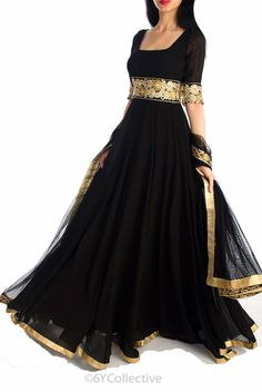 Black floor length kali style anarkali in georgette with floral embroidered lace at the empire waist and rose gold border at the hemline. waist; square neck with deep scoop back Elbow Sleeves without lining paired with floral borders. Black net dupatta with floral embroidery on all sides, rich embroidery in zari and resham adorns the waistline Fabric: Georgette visit -www.suitsaristore.com www.facebook.com/designersuitsandsari