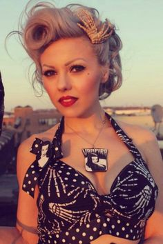 Psychobilly pin up girl with polka dot skeleton dress, hair clips, Vampira necklace, brooch, & retro rockabilly hairdo