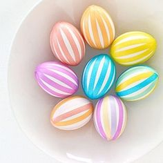 Striped Easter Eggs: Use Japanese Washi Tape to make bright stripes or layer bits of tape for a mosaic. by Aida Ines