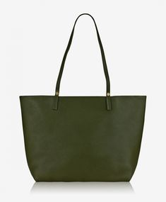 f322f27ff17b3d Soft leather tote opens to an unlined interior with large interior zip  pocket, the slender