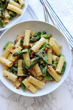 Pasta with asparagus and sun dried tomatoes. An easy spring pasta recipe featuring asparagus and sun dried tomatoes tossed with a lemon basil dressing.