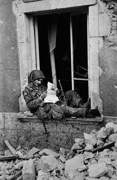 An American soldier in Saint-Sauveur-le-Vicomte, France - 16 June 1944.    Photo by Robert Capa.