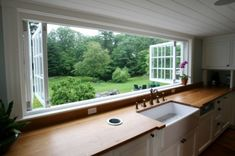 Large Kitchen WindowChoosing the best kitchen window for your house can make a huge difference in appeal, convenience and space. What we have here is an example of the large window design-build by … Eclectic Kitchen, New Kitchen, Kitchen Sink, Long Kitchen, Kitchen Countertops, Kitchen Pass, Kitchen Ideas, Wooden Countertops, Kitchen Cupboard