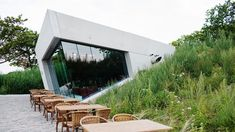 In the dunes between The Hague and Scheveningen at the entrance of the water company Dunea, an The Dunes, Outdoor Furniture, Outdoor Decor, Sun Lounger, Entrance, Grass, Concrete, Restaurant, Water