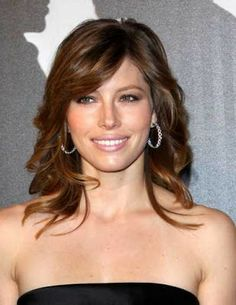 medium hair cut with loose curls and side bangs