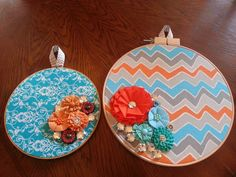Embroidery hoop wall hangings. Fabric with fabric flowers and jewel embelishments.  @Jaime Stahl