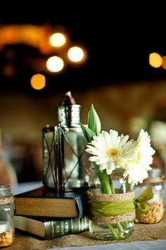 Lanterns, flowers in mason jars, twine, no books :)