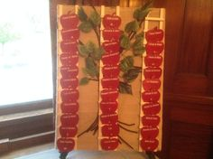 Place cards Re wooden apples on a ladder in front of an apple tree... Bride and groom got engaged under an apple tree! This was the mother of the brides creation.. Pretty cool idea!