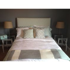 Homemade headboard-not the fabric I would choose, but I like the simplicity of the rectangle.