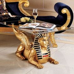 Design Toscano Egyptian Sphinx Glass Topped Sculptural Table in Faux Gold and Egyptian Palette -- You can get additional details at the image link.Note:It is affiliate link to Amazon.