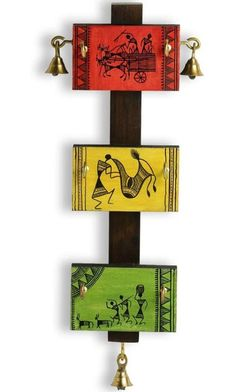 Handcrafted in wood by artisans and craftsmen from the Rural parts of India, this Warli art wall mount key holder is inspired from the simple everyday life of Indian tribes. It is hand painted with detailed warli art. There are six key hooks and 3 metal bells as accents. A perfect holder to organise Clay Wall Art, Mural Wall Art, Wood Wall Art, Art N Craft, Diy Art, Craft Work, Madhubani Art, Madhubani Painting, Worli Painting
