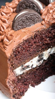 Chocolate Cake with Oreo Cream Filling ~ It's amazing... One killer delicious cake with a delicious buttercream frosting with big oreo cookie chunks.
