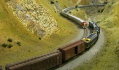 A westbound Santa Fe passenger train and an eastbound Santa Fe freight train meeting at East Marcel, on the GEHAMS N scale layout