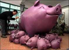 Artist Chen Jingzhong puts the finishing touches on his giant pig sculpture as China prepares to welcome the Year of the Pig in February 2007