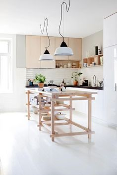 A portable kitchen island is a great way to create extra bench space to a compact kitchen as well as extra storage.