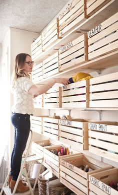 Wooden crates from the craft store to organize supplies, or tools in the garage. Brilliant idea.