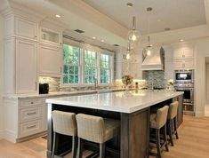 There is no question that designing a new kitchen layout for a large kitchen is much easier than for a small kitchen. A large kitchen provides a designer with adequate space to incorporate many convenient kitchen accessories such as wall ovens, raised. Kitchen With Big Island, Big Kitchen, Kitchen Redo, Kitchen Islands, Kitchen Island Seating, Kitchen Ideas, Island Chairs, Large Kitchens With Islands, Awesome Kitchen