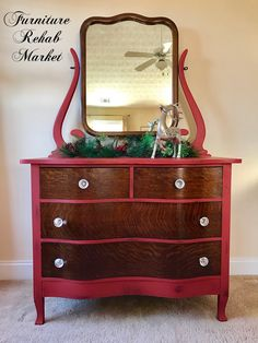 """This antique Princess Dresser features beautiful serpentine Tiger Oak drawers with dovetail construction, stunning glass knobs, and an adjustable vanity mirror. Made by K.P.L Furniture of Corry, PA. Circa 1918. Custom chalk painted and protected with a wax sealer. Color: Ruby. Dimensions: 42.5"""" W x 20"""" D x 33"""" H (68"""" H with mirror)"""