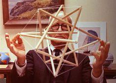 Buckminster Fuller holding a tensegrity.