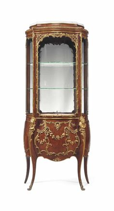 A FRENCH ORMOLU-MOUNTED TULIPWOOD VITRINE CABINET -  LATE 19TH/EARLY 20TH CENTURY