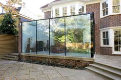 The glass beams supporting the frameless glass roof were supported by hidden steel supports creating a frameless glass finish. House Extension Design, Extension Designs, Glass Extension, Rear Extension, Extension Ideas, Glass Conservatory, Glass Room, Glass Walls, Glass Structure