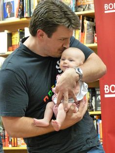 Ok, I'm not one of those baby crazy women, but seeing Nathan Fillion holding a baby so lovingly just about made my heart burst out of my chest!
