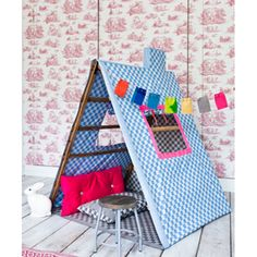 PVC DIY Projects - The Cottage Market. I've seen many versions of a playhouse, but the fabric window and chimney on this one are cute.