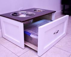 Pets Care - Raised Dog Feeding Station The way cats and dogs eat is related to their animal behavior and their different domestication process. Raised Dog Feeder, Elevated Dog Feeder, Raised Dog Bowls, Dog Food Storage, Diy Storage, Hidden Storage, Dog Feeding Station, Dog Station, Dog Bowl Stand