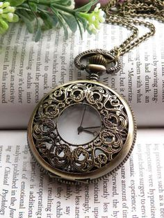 Retro copper round hollow carved flower pocket watch necklace pendant jewelry vintage style w2. $6.99, via Etsy.