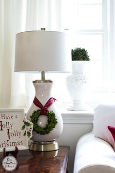 Love this lamp with the mini boxwood wreath tied on!!  Simple, budget-friendly Christmas Home Decor ideas. Inspiration for porches, entries and living spaces.