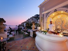 Positano, Italy    Hotel: Le Sirenuse    What you'll see: the hillside homes of Positano on the coast, the Bay of Positano all around
